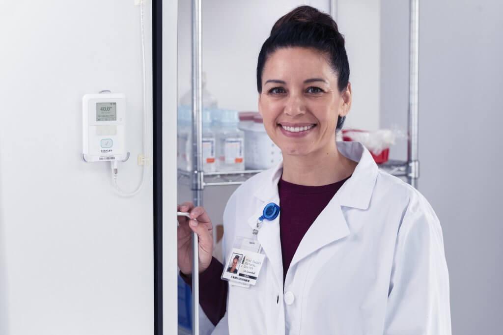T15e pharmacist smiling by fridge